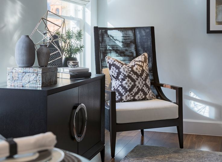 Rich in deep tones of dark wood, we dressed this statement chair with a Andrew Martin Sketch velvet fabric cushion, the beautiful ikat design with geometric diamond and spot detailing infusing the design with gentle tranquility.