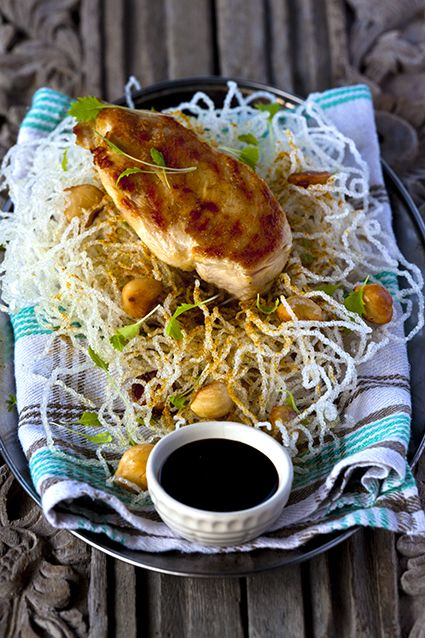 Street food. Chicken breast with deep-fried noodles and home-made ketjap manis