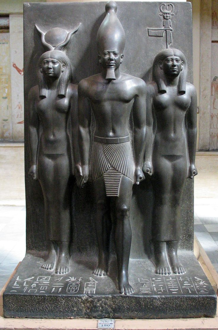 Graywacke statue of Menkaure, accompanied by the goddess Hathor (right) and the personification of the nome of Diospolis Parva (left).