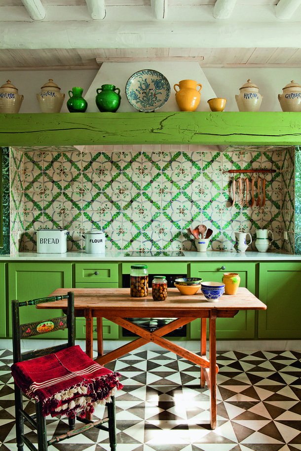 wow. Really this is pretty much my quintessential kitchen, I am obsessed with vivid greens in kitchens, miss matched tiles and deep stains.