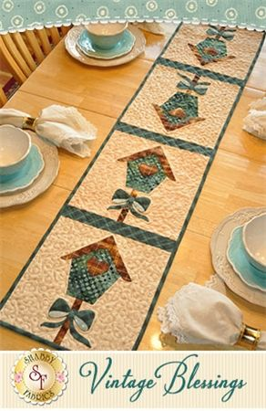 """Vintage Blessings Table Runner - March Pattern: Decorate your home all year long with a beautiful Vintage Blessings Table Runner by Jennifer Bosworth of Shabby Fabrics. This pattern is for the March design. Table Runner measures approximately 12 1/2"""" x 53""""."""