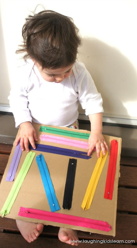 Stick discarded zippers onto a board for little ones to play with. They make a lovely noise as well.