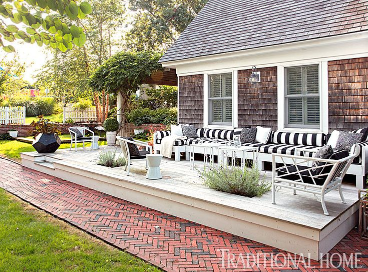 Relaxation is easy on vintage faux bamboo chairs topped for Cape cod house with porch