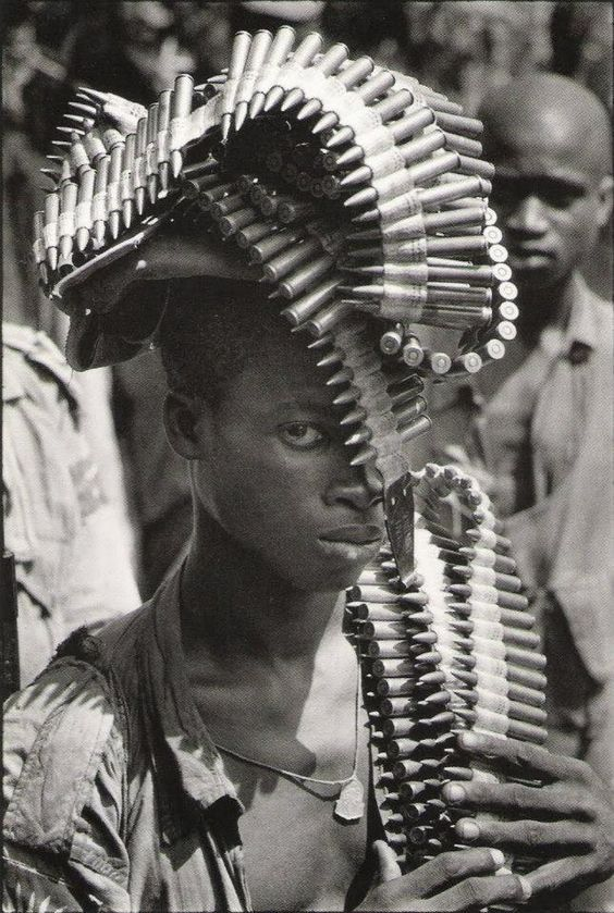 Igbo soldier during the Nigerian Civil War [Igbo Soldier Biafra Nigeria Nov 1968 by Gilles Caron]