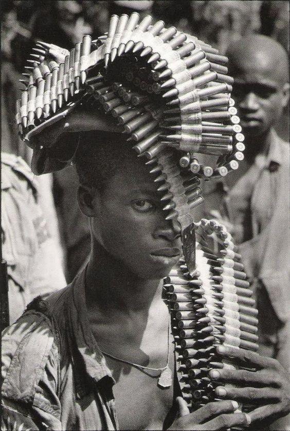 Igbo soldier during the Nigerian Civil War [Igbo Soldier Biafra Nigeria Nov 1968 by Gilles Caron]