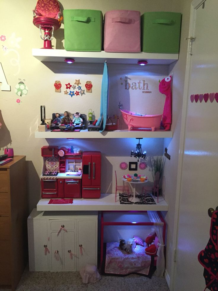 American Girl Home! Done with IKEA shelves, Our Generation Furniture, Dollar Tree LED lights and a locker chandelier. Our little one loves it :)