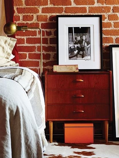 A black and white photo lays next to Brent Bolthouse's bed side table: Side Table, Exposed Bricks, White Photo, Photo Lays, Beautiful Bedrooms