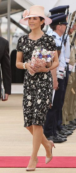 Crown Princess Mary of Denmark - 2011 She is wearing a Ralph Lauren Blue Label Devon Vintage Floral Dress with Susanne Juul hat.
