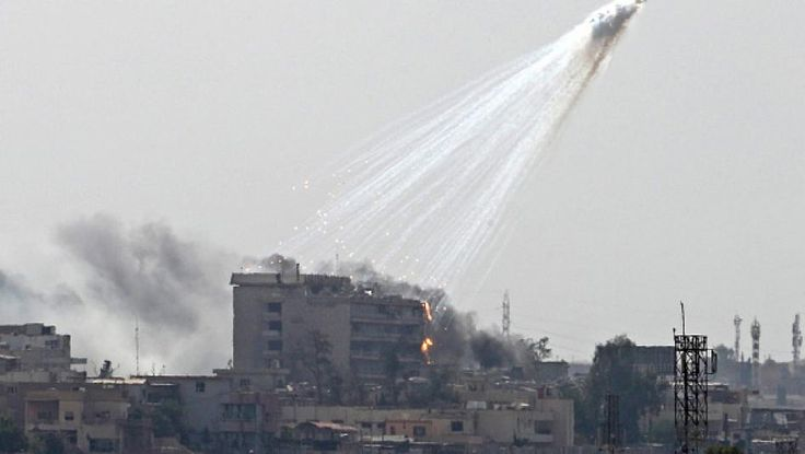 US bomb sends smoking and burning white phosphorus streaking to the ground in west Mosul on June 2, 2017.