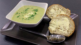Creamy leek and potato soup with melted brie