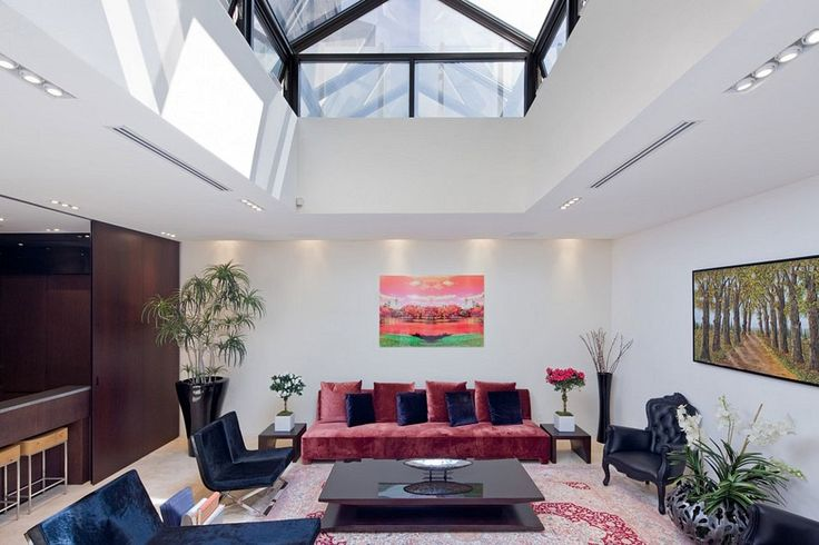 Architecture, Adorable Private House Including Living Room With Red Sofa And Black Lounge Chair Featuring Wooden Table Added On Red Carpet Combined With White Wall And Glass Skylight: Private House Designs with Splendid and Luxurious Contemporary Themes