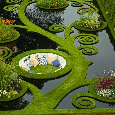 Dream Garden. Gold medal garden at the Ellerslie Flower Show by Ben Hoyle, Blue Gecko.  French grassed parterre floating over still black waters. New Zealand.