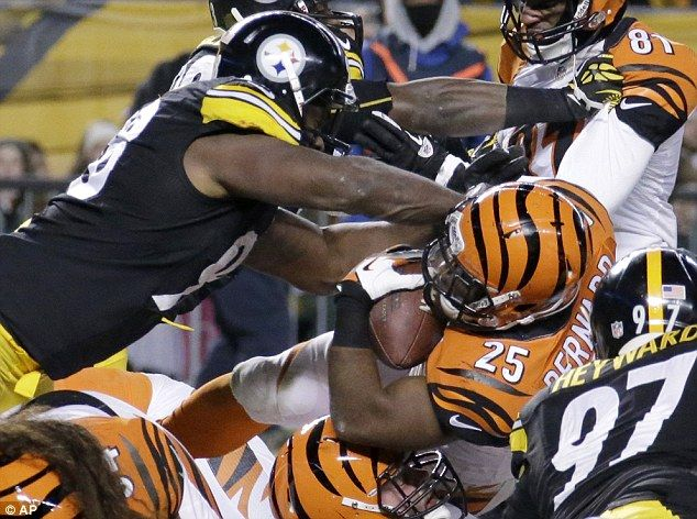 Impact: Cincinnati running back Gio Bernard gets hit by Pittsburgh Steelers defensive end Ziggy Hood. Steelers won 30-20. 12/2013