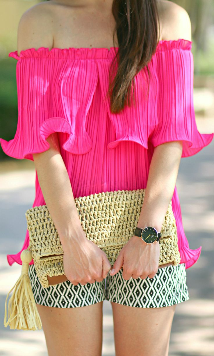 Hot pink pleated Bardot top, black geo print shorts, Ann Taylor straw clutch, andDaniel Wellington black Sheffield watch | The Bardot Top: What It Is (and How to Wear It) by Stephanie Ziajka from Diary of a Debutante