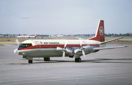 CF-TKK (734) Vickers V.952F Vanguard Cargoliner at CYUL/Montreal-Dorval in September 1971. This aircraft was converted to a freighter by Air Canada (fleet number 911) in 1966. It later went to Europe Air Service as F-BTYB. Note smokey company DC-9 on short finals also two other Vanguards at mainenance.