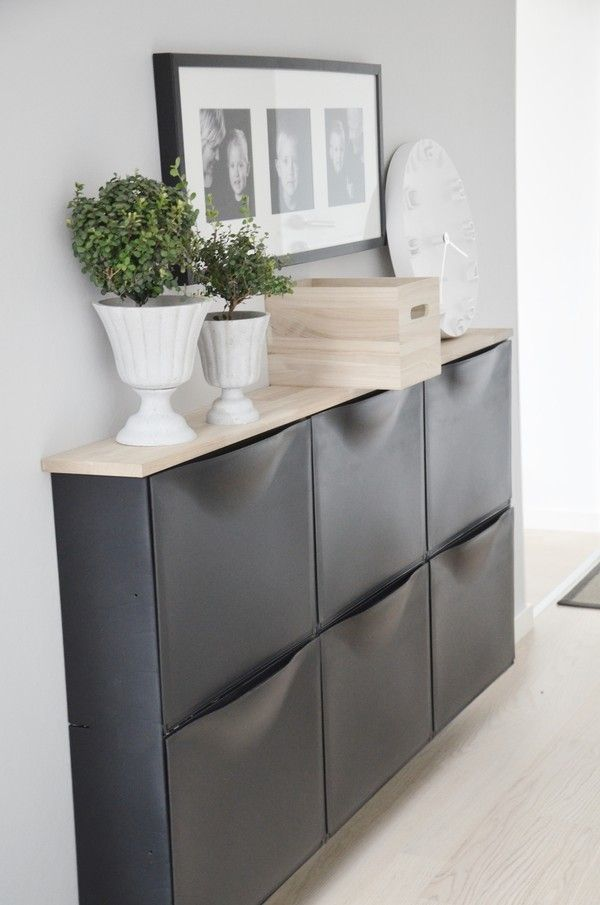 Ikea's wall-mounted shoe cabinets in black with light wood top.  Not just for shoes! ;-)