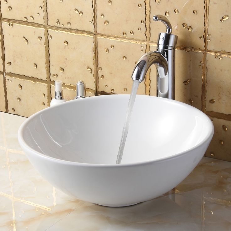 Enhance The Style And Functionality Of Your Bathroom With Graceful Curves This Countertop Vessel Clean White Sinkbathroom