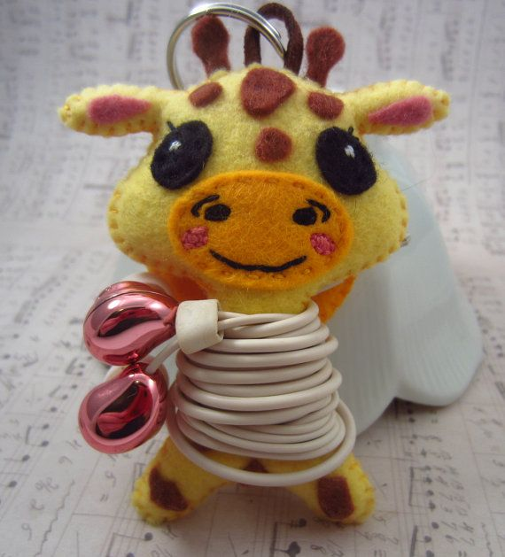 Adorable Giraffe Earbud Holder/Keychain. Keep your buds secure and handy with this cute little giraffe. Now available at Heart Felt Plush.