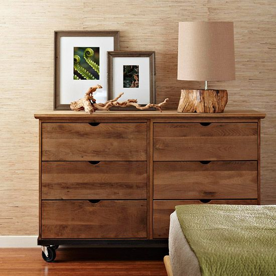 This dresser, made from salvaged oak, is outfitted with twisted tree roots, a lamp with a driftwood base.