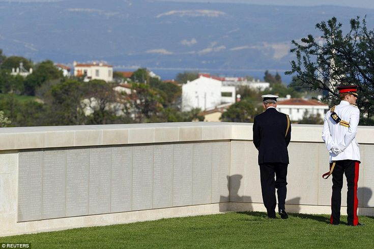 Mournful: Prince Charles and Prince Harry read names written on a wall during a visit to the Cape Helles British Memorial this afternoon