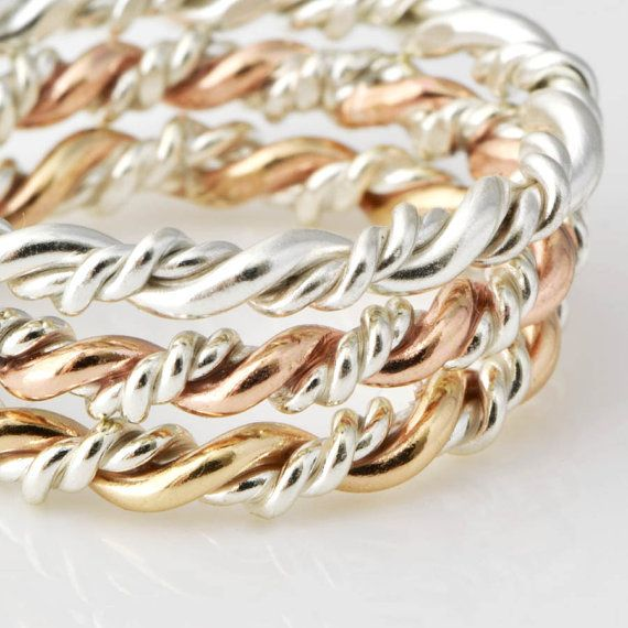 Argentium Sterling Silver and 14kt Gold Filled Twisted Pattern Ring - this listing is for 1 ring  Very versatile ring! Hand fabricated from argentium sterling silver and 14kt gold filled wire. Double twist pattern design in the dual tone makes it a great unifying piece when wearing gold and silver together. Wear it as part of a set by stacking rings together, by itself on a ring finger or alone as a thumb ring. Would also be a great midi ring.This ring can be made in any size just mention…