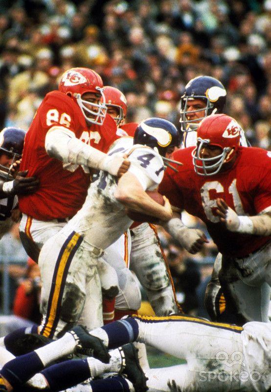 Kansas City Chiefs defensive end (86) Buck Buchanan and line backer (61) Curley Culp stop Minnesota Vikings running back (41) Dave Osborn