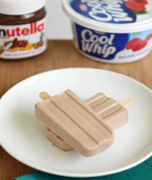 Mix together 2 cups of Cool Whip, 6 tbsp. of Nutella, 1 cup of milk. Pour into popcicle molds. Freeze for a few hours.
