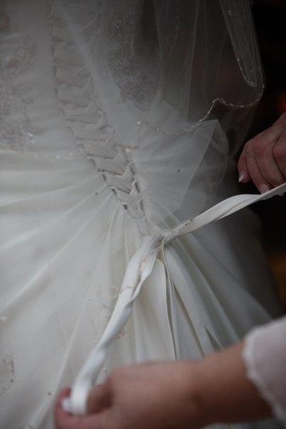 Mom finishing up the back of my dress