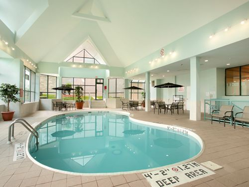Our indoor heated pool is located right off of the lobby with an outdoor view and easy access to our games room.  It is open year round so that you can cool off after a long day, swim laps to keep in shape or simply work on your cannon balls.