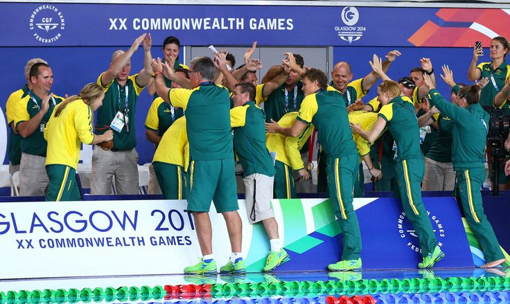 Cate Campbell, Emma McKeon, Melanie Schlanger and Bronte Campbell of Australia walk through a guard of honour after winning the gold medal in the Women's 4 x 100m Freestyle Relay Final in a world record time