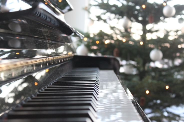 The piano by the christmas tree on We Heart It