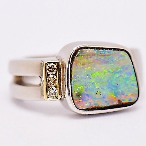 Sterling Silver Queensland Boulder Opal Ring with 18ct Yellow Gold detail and set with Champagne Diamonds. #fremantleopals #opals #boulderopal #champagnediamond