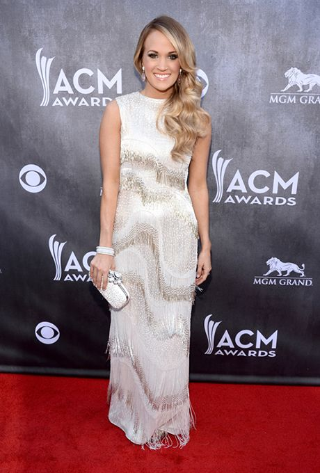 Brides.com: . Carrie Underwood in Oscar de la Renta at the 2014 Academy of Country Music Awards.