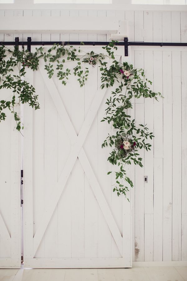 Foliage accented white barn wedding: http://www.stylemepretty.com/2016/03/31/rustic-white-sparrow-barn-wedding/ | Photography: Shaun Menary - http://shaunmenary.com/