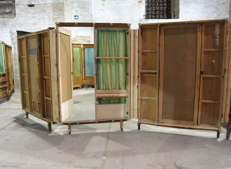 wardrobe doors creating temporary spatial divides...This work by Song Dong at the Venice Biennale 2011 had me thinking about shop interiors...