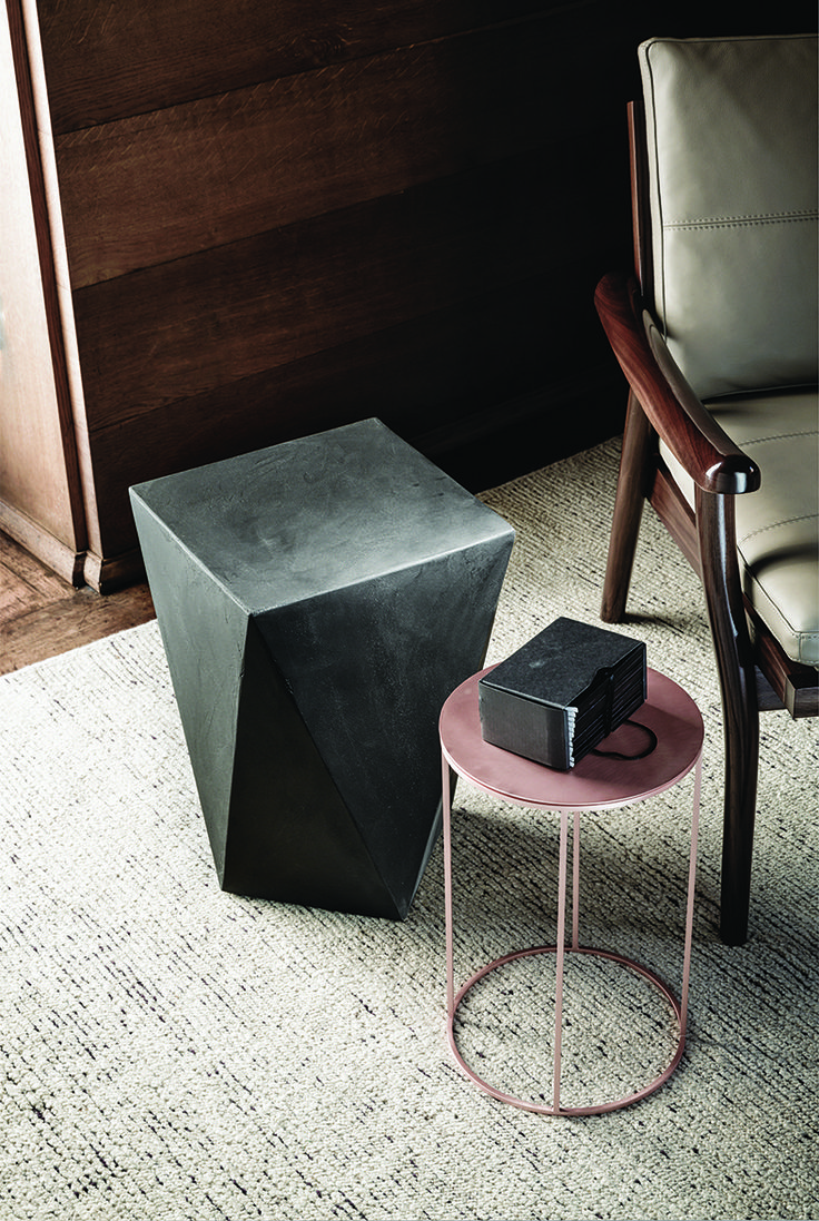 9500 side table 43 is a steel or painted metal table inspired by the shape of a prism. The 9500 side table 43 has an outstanding and unordinary design. The rigorous geometric shape inspired by a prism can design contemporary spaces without compromises. design: Gianluigi Landoni