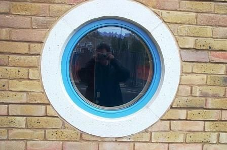 Quirky port hole window which our team spray painted blue along with the rest of the buildings windows To see more visit http://www.vandacoatings.co.uk/ #spraypaint #restore