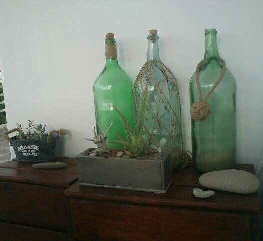 My DIY Upcycled old damijons for my Greek veranda....