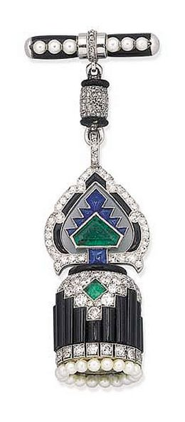 An Art Deco onyx and gem-set pendant watch, by Cartier  With circular cream dial, blued steel hands, Roman numerals within a pearl border, onyx and diamond geometric cylindrical case to the openwork diamond and gem-set palmette motif and diamond barrel-shaped surmount, with pearl and enamel clasp, circa 1925 Dial signed Cartier, London, No. 7240