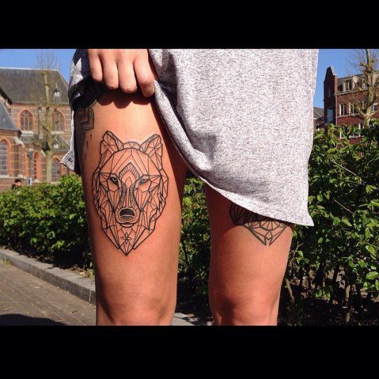 geometric wolf tattoo on hip