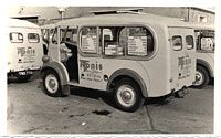 First up, a rear view showing a fleet of Morris J Type vans in Toni's colours. On offer were cones, wafers, fruities, choc bars, & gateaux. Reg. nos visible are 852 EMG & YMX 770.