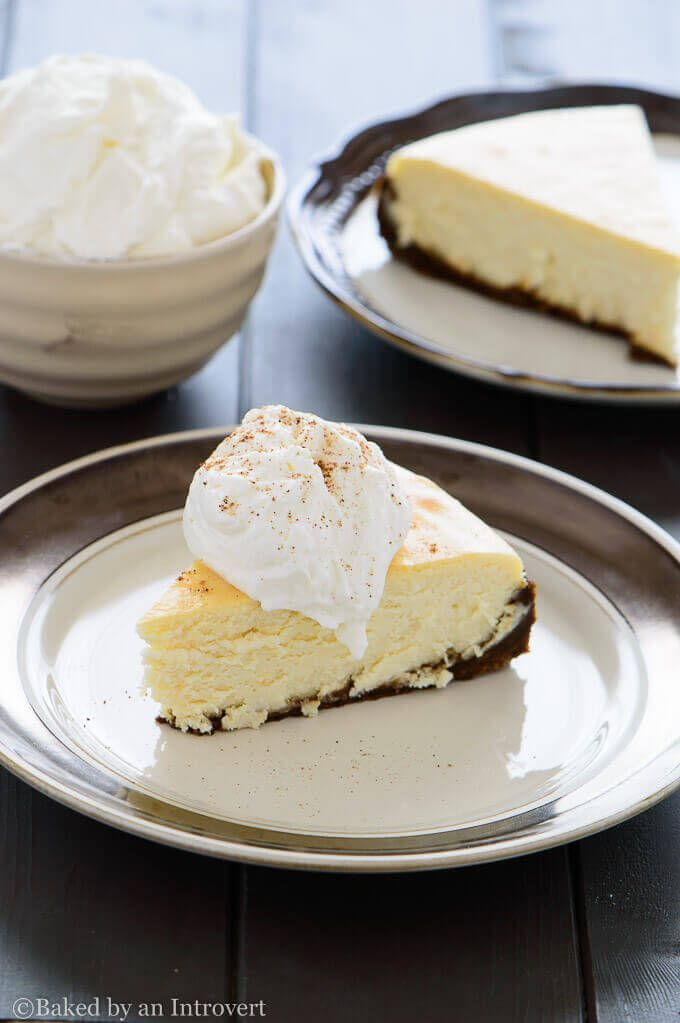 Eggnog Cheesecake - Divine eggnog cheesecake on top of a gingersnap crust, topped with eggnog whipped cream. This is something every eggnog lover must try!