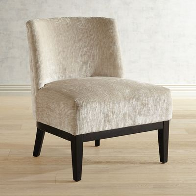 Corinne's larger seat and rounded back provide added support, deluxe style and comfort. With a padded seat, solid wood legs, frame and fabric upholstery, this is a well-bred slipper chair with superior genes.