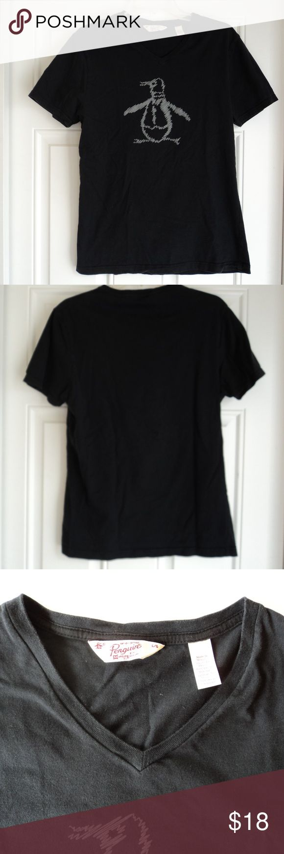 "Original Penguin Men's V-Neck T-shirt Large Penguin brand Men's V-Neck T-shirt Large short sleeve.  Black with grey Penguin emblem embossed on the front. Gently used condition. 100% cotton. It measures 19"" from underarm to underarm, 26.5"" in length from top of shoulder to bottom hem. Sleeve length 8"". Pet free and smoke free home. Original Penguin Shirts Tees - Short Sleeve"
