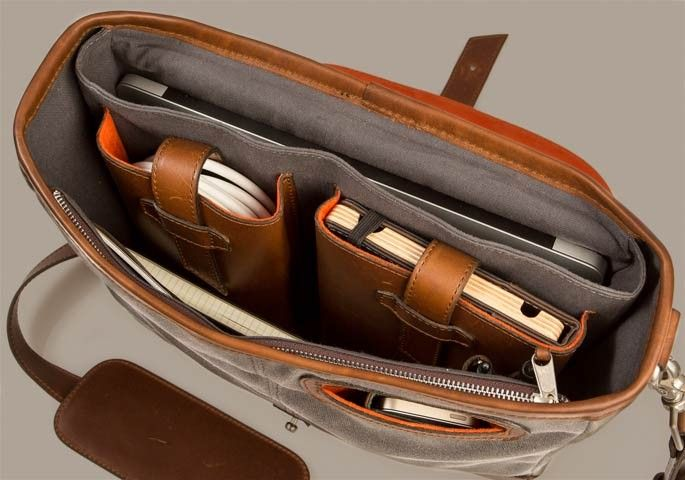 The Messenger Bag by Pad & Quill $369.00 Holds a 15-inch macbook pro with plenty of extra space for books, accessories and just plain old miscellanea