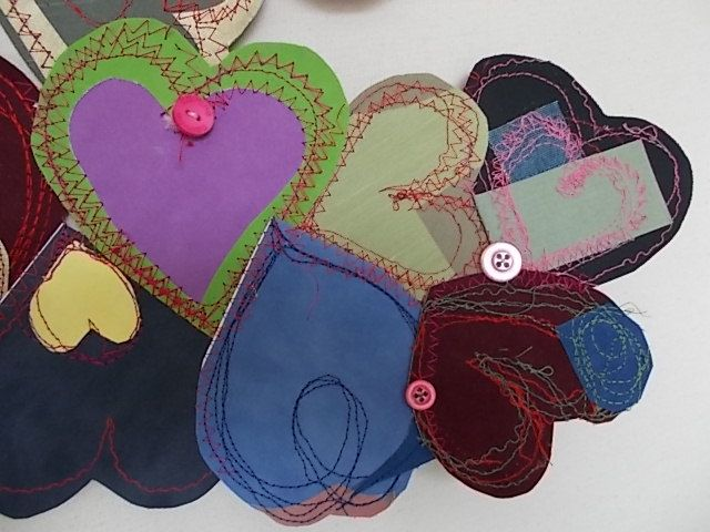 Fabric hearts 5o of them, double sided make 100 tactile textiles.