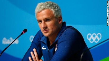 Rio cops question US swimmer Ryan Lochte's robbery story Police arrived Wednesday morning at the Olympic Village to take the swimmers' passports and gather further testimony from them about the reported robbery, US Olympic Committee spokesman Patrick Sandusky said.