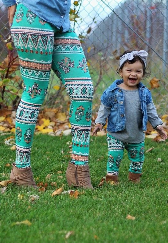 Mommy and me matching outfit. A gorgeous turquoise leggings set with tribal inspired peach color markings and white wildflowers that will easily create a great mother and daughter outfit for any photo shoot. This bluish green pant set is part of Made by Jeniffer mommy and me leggings collection.
