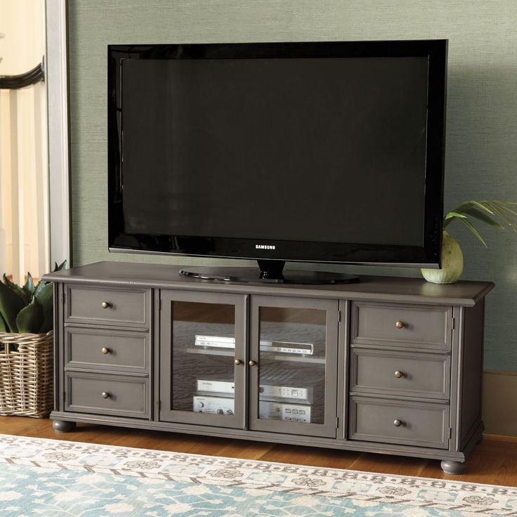 """Vetrina 60 inch Media ConsoleOverall: 22 1/2""""H X 60""""W X 18""""D   $800 Center Cabinet: 18 1/2""""H X 26 3/4""""W X 15 1/4""""D w/Adj. Shelf (7 positions) Side Faux Drawer Cabinets: 18 1/2""""H X 14""""W X 15 1/4""""D w/Fixed Shelf Center Cabinet has 2 cable ports. Side Cabinets have 9 1/4""""H above and below the fixed shelf. Holds most TVs up to 65"""". Construction: Constructed of hardwood and wood veneers. Country of Origin: Italy"""