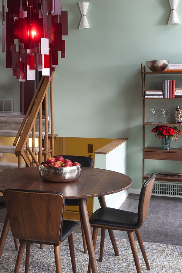 Warm walnut additions create cohesion in this colorful dining space.